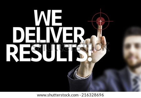 Business man pointing to black board with text: We Deliver Results! - stock photo