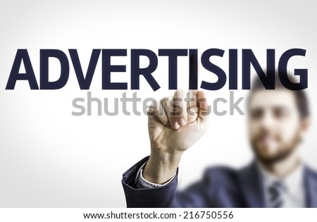 Business man pointing to transparent board with text: Advertising - stock photo
