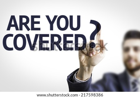 Business man pointing to transparent board with text: Are you Covered? - stock photo