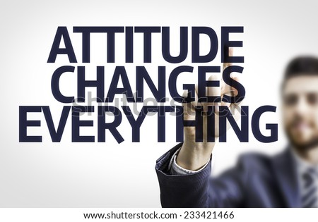 Business man pointing to transparent board with text: Attitude Changes Everything  - stock photo