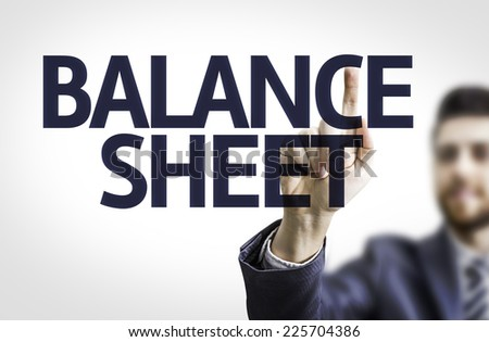 Business man pointing to transparent board with text: Balance Sheet - stock photo