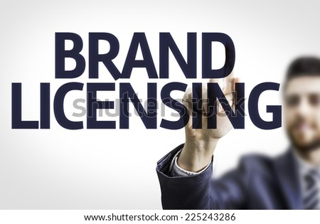Business man pointing to transparent board with text: Brand Licensing - stock photo