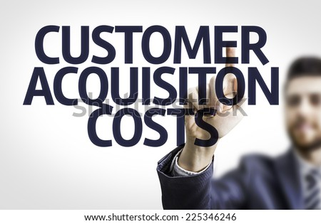 Business man pointing to transparent board with text: Customer Acquisition Costs - stock photo