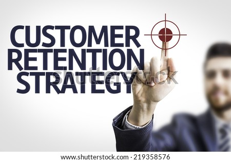 Business man pointing to transparent board with text: Customer Retention Strategy - stock photo