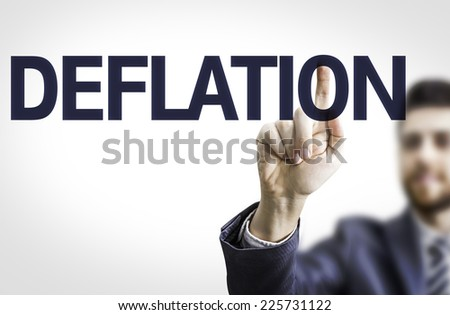 Business man pointing to transparent board with text: Deflation - stock photo