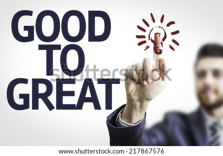Business man pointing to transparent board with text: Good To Great