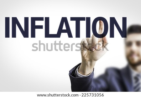 Business man pointing to transparent board with text: Inflation - stock photo