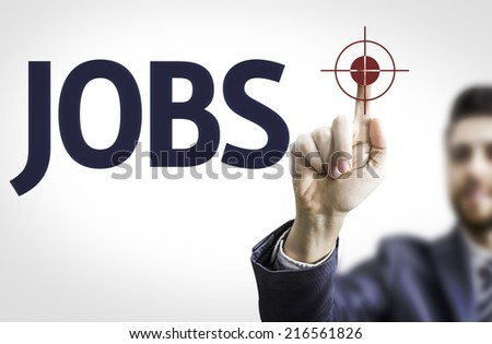 Business man pointing to transparent board with text: Jobs - stock photo
