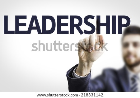 Business man pointing to transparent board with text: Leadership - stock photo