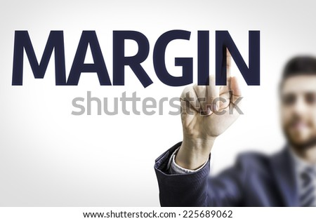 Business man pointing to transparent board with text: Margin - stock photo
