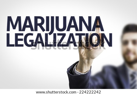 Business man pointing to transparent board with text: Marijuana Legalization  - stock photo