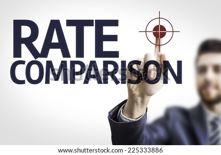Business man pointing to transparent board with text: Rate Comparison - stock photo