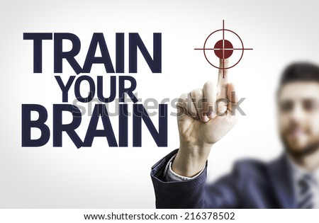 Business man pointing to transparent board with text: Train your Brain - stock photo