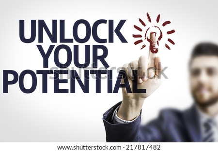 Business man pointing to transparent board with text: Unlock Your Potential - stock photo