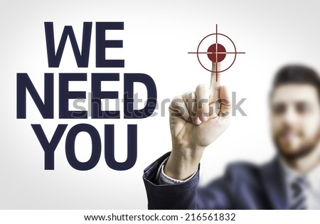 Business man pointing to transparent board with text: We Need You - stock photo