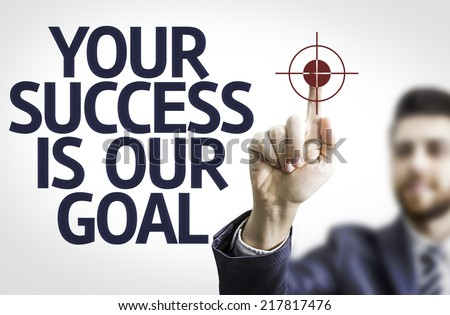 Business man pointing to transparent board with text: Your Success Is Our Goal - stock photo