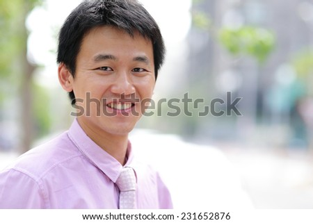 Business man portrait, he smile to you, asian - stock photo