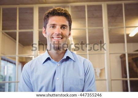 Business man posing alone in office - stock photo