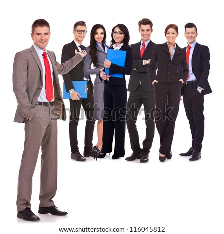 business man presenting his successful happy team isolated over a white background