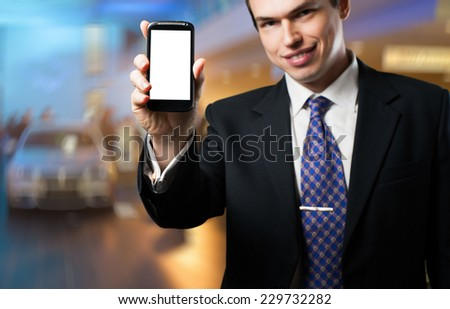 Business man presenting mobile application with copy space on screen - stock photo