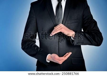 Business man presenting something on blue - stock photo