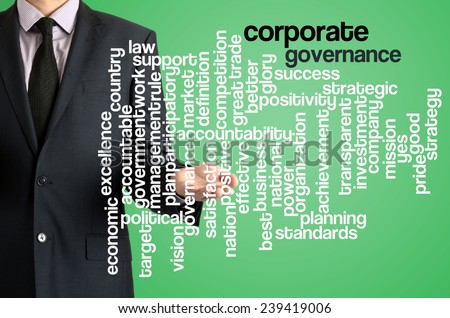 Business man presenting wordcloud related to corporate governance on virtual screen - stock photo