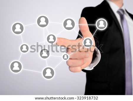 Business man press people icon button - stock photo
