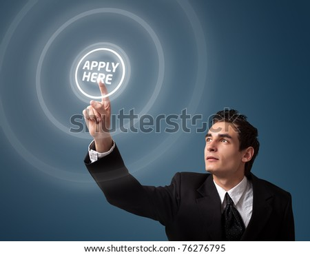 """Business man pressing a """"Apply HERE"""" button. - stock photo"""