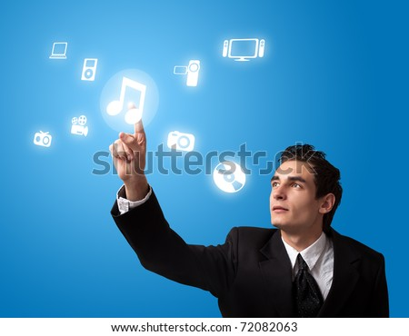 business man pressing a MUSIC button - stock photo
