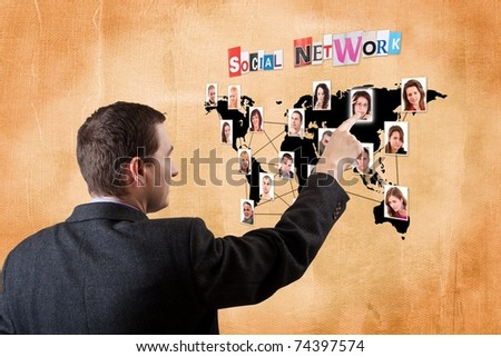 business man pressing a social network map - stock photo