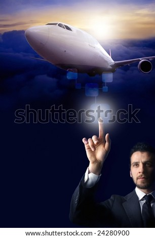 Business man pressing a touchscreen button for airplane take-off - stock photo