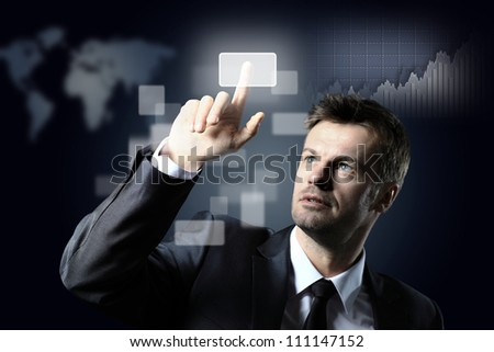 business man pressing a virtual button - stock photo
