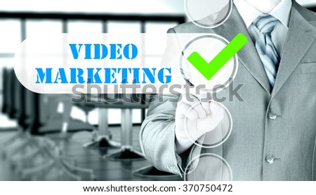 business man pressing checkbox Video Marketing - stock photo