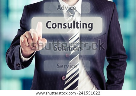 Business man pressing consulting button at his office. Consulting concept, toned photo. - stock photo