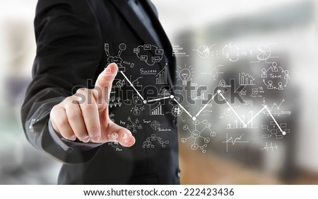 Business man pressing high tech type of modern graph - stock photo