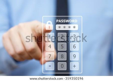 Business man pressing security code on virtual keypad - stock photo