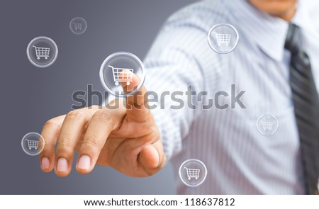 Business man pressing shopping cart icon - stock photo