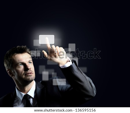 Business man pressing virtual button - stock photo