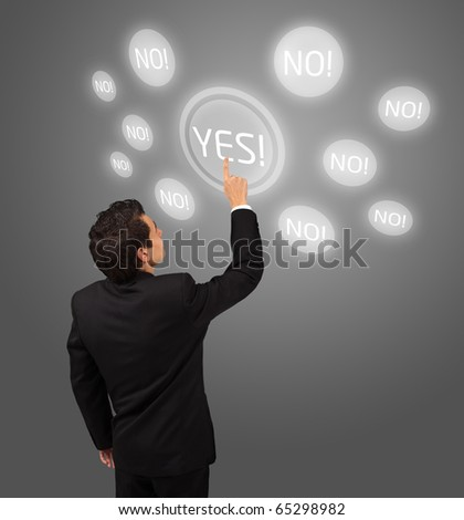 business man pressing YES button - stock photo