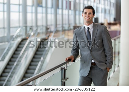 Business man professional portrait pose traveling for work at the airport station confident and successful expression - stock photo
