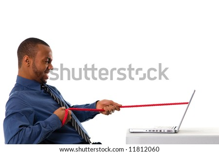 business man pulling a rope through his laptop - stock photo