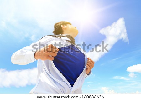 Business man pulling his t-shirt open, showing copy space with a superhero suit , sky and arrow cloud background - stock photo