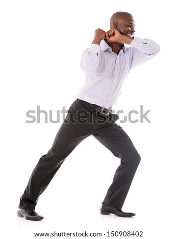 Business man pulling something imaginary - isolated over white background  - stock photo