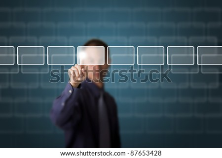 business man push a touch screen button - stock photo