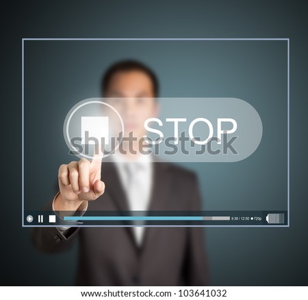business man push stop button on touch screen to end video clip - stock photo