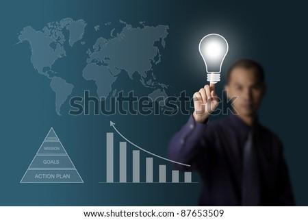 business man pushing light bulb - stock photo