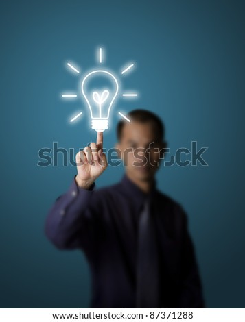 business man pushing light bulb button - stock photo