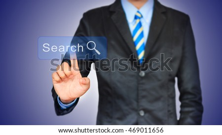 Business man pushing search button on a touch screen interface