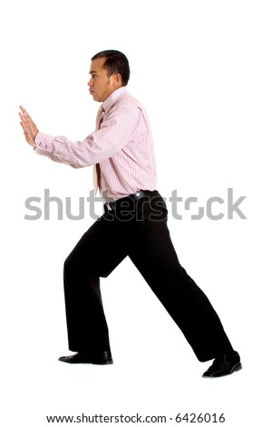 business man pushing something isolated over a white background