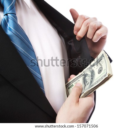 Business Man putting a wad of cash in his suit jacket pocket on white background